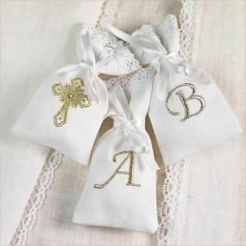 мешочек с буквой для первого локона или крестика