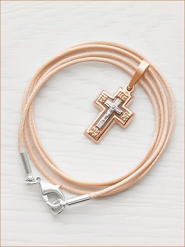золотой крестик и шнурок с серебряной застежкой